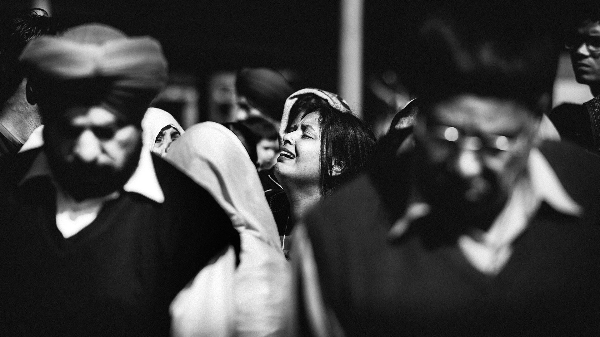 Woman crying in a crowd